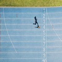 Track and field track with sprinter in overhead shot